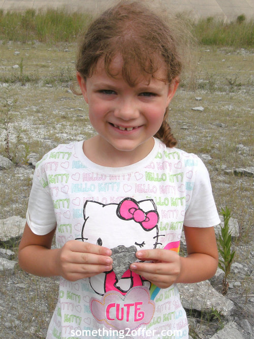 girl holding fossil