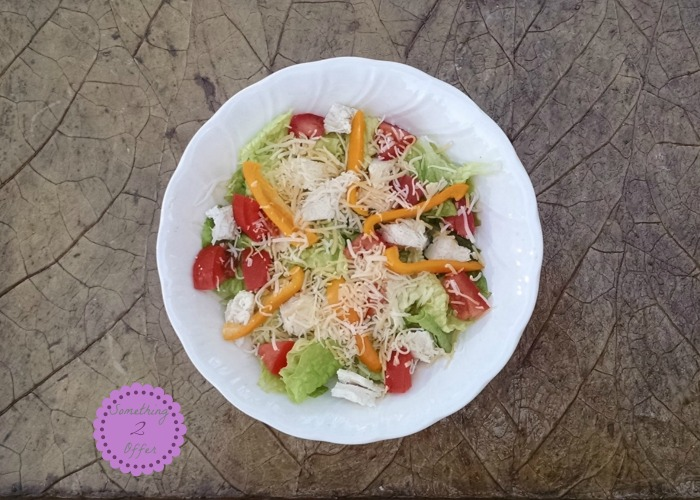 bowl of lettuce chicken tomatoes pepper cheese