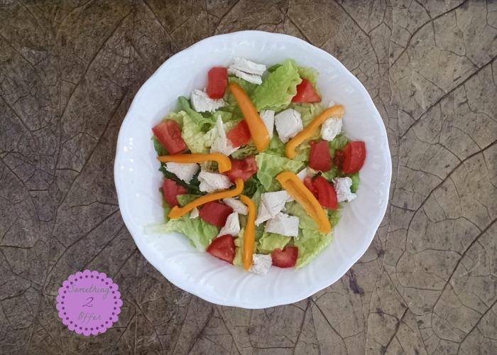 bowl of lettuce chicken tomatoes pepper