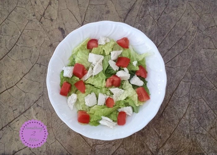 bowl of lettuce chicken tomatoes