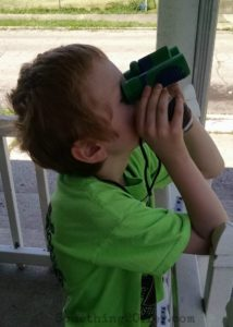 Big Red using binoculars