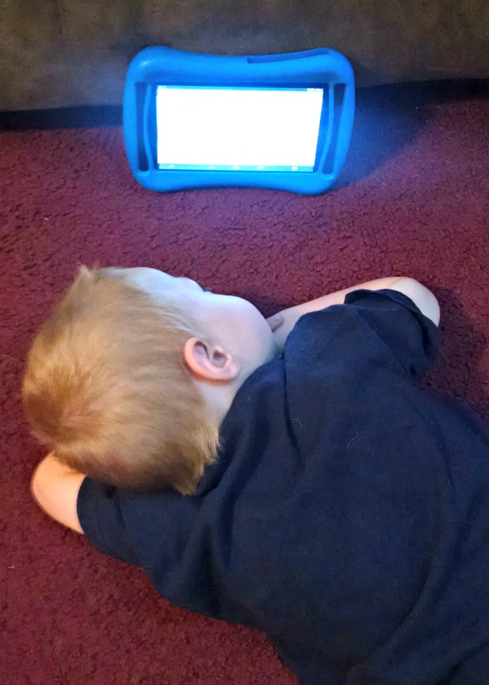 Lil' Red looking at tablet